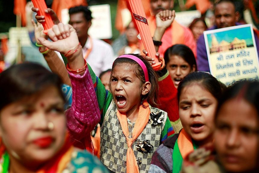 Protesters at a demonstration organised by the hardline United Hindu Front group to mark the 26th anniversary of the razing of the 16th-century Babri mosque in the city of Ayodhya in Uttar Pradesh.