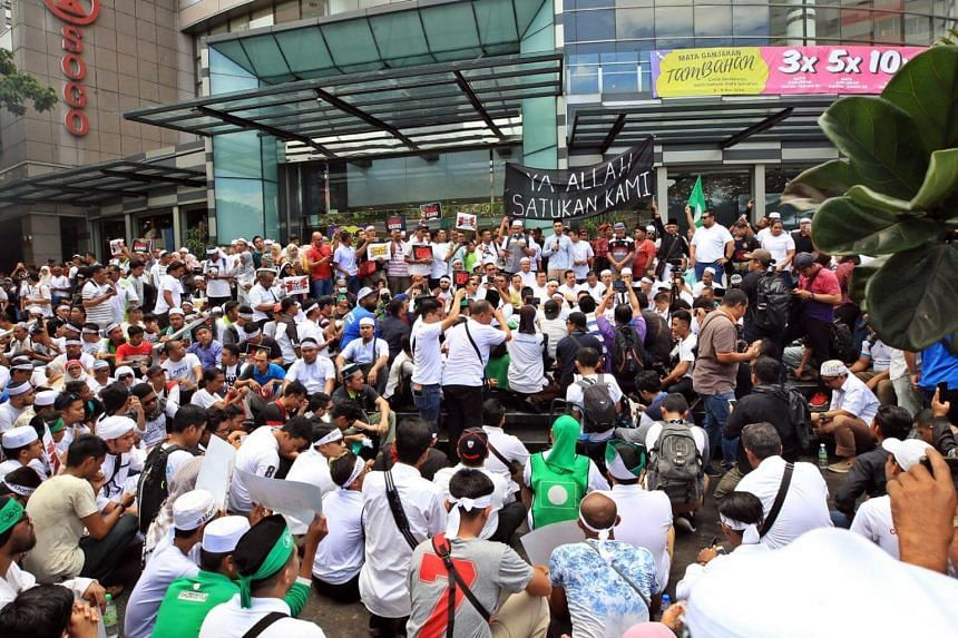 The youth wings of Umno and Parti Islam SeMalaysia at a joint rally in Kuala Lumpur in November against Malaysia's intention then to ratify the International Convention on the Elimination of All Forms of Racial Discrimination.