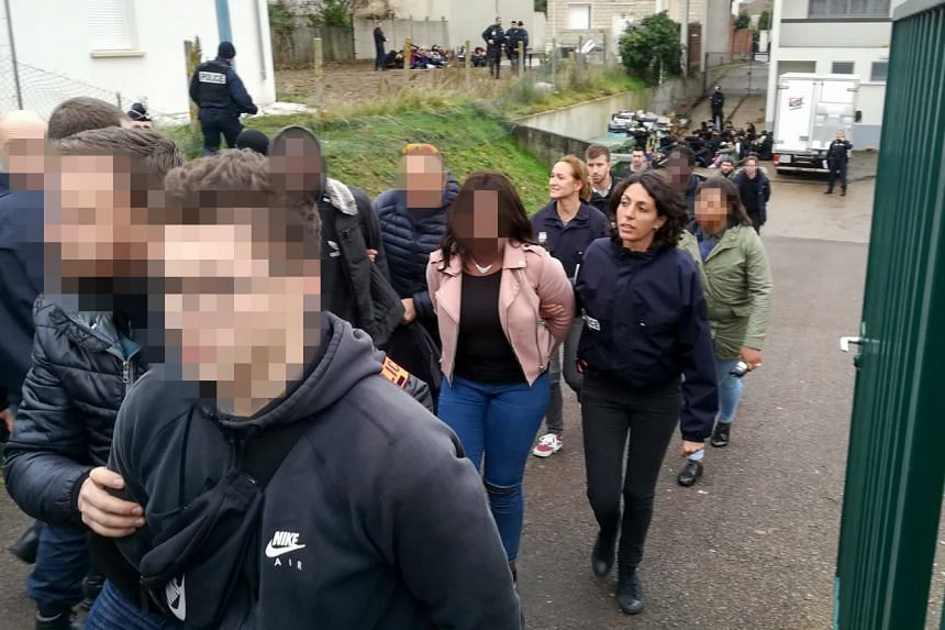 French police arrest students close to the Saint-Exupery high school in Mantes-la-Jolie in the Yvelines, following clashes in which 146 people were arrested on Dec 6, 2018.