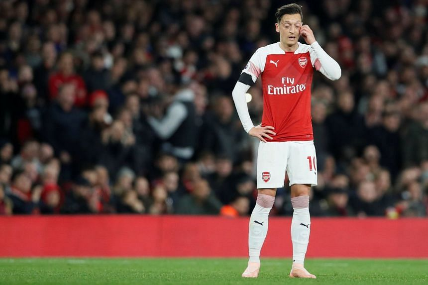 Arsenal manager Unai Emery, it seems, had already decided he could do without Mesut Ozil (above) in his comprehensive overhaul of a squad.