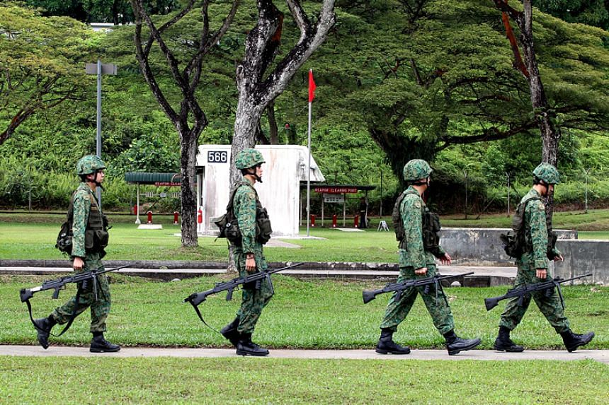 File photo of NSmen carrying their weapons for a live-firing exercise at Nee Soon Camp. The Singapore Armed Forces will be conducting military exercises across Singapore next week, including live-firing exercises by the army and the air force.