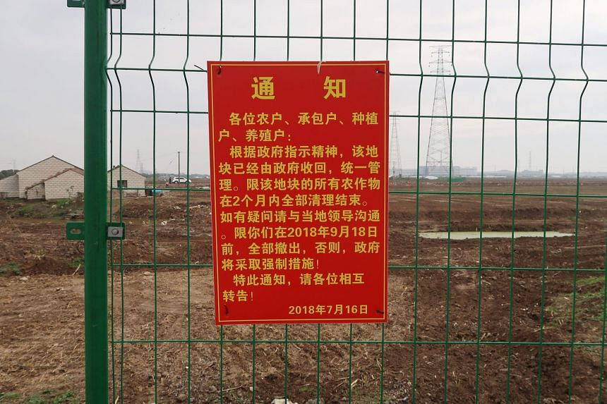 A government announcement of a land request at the site slated for Tesla's factory in Shanghai. The notice, posted on July 16, gave farmers till Sept 18 to vacate the land.