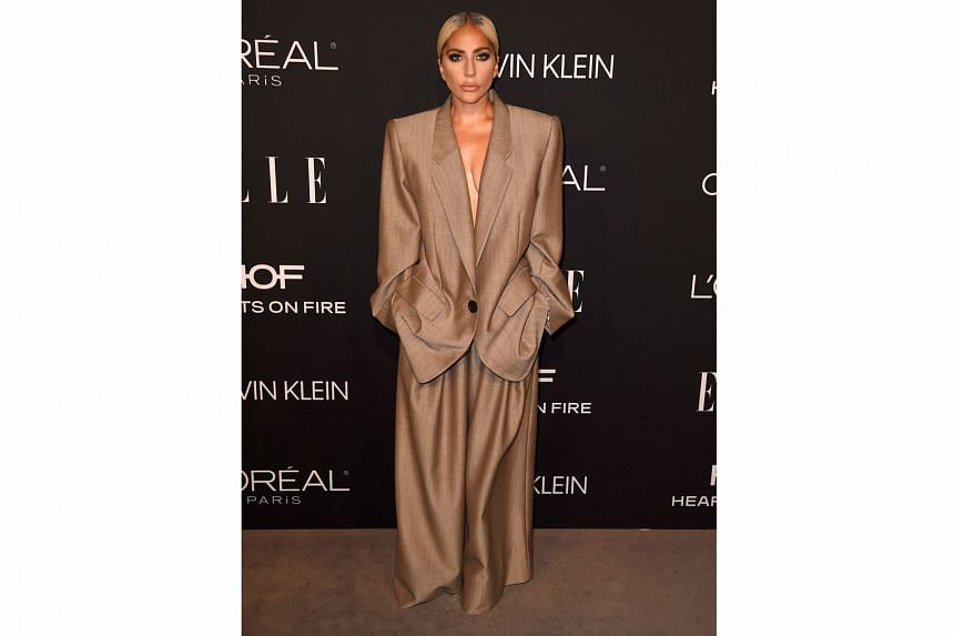 Pop star Lady Gaga wearing an oversized pantsuit by Marc Jacobs to the 25th Annual Elle Women in Hollywood celebration in Beverly Hills in October.