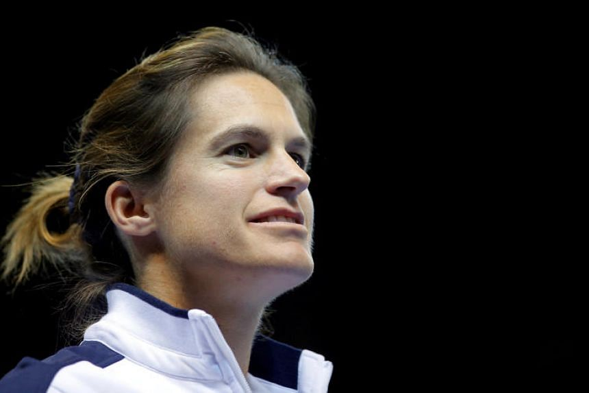 France's team Captain Amelie Mauresmo arrives on the court for the Fed Cup final between France and the Czech Republic in Strasbourg, France on Nov 12, 2016.