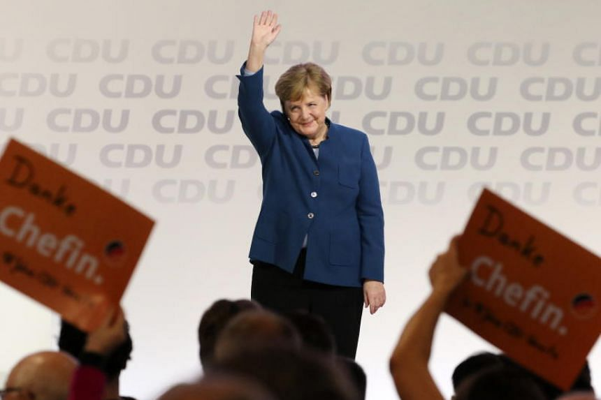 German Chancellor Angela Merkel waves at the end of her speech during the 31st Party Congress of the Christian Democratic Union in Hamburg, Germany, on Dec 7, 2018.