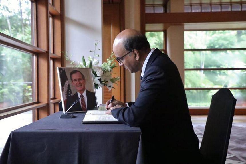 Writing in the condolence book at the US Ambassador's Residence in Singapore on Dec 6, 2018, Deputy Prime Minister Tharman Shanmugaratnam noted that countries around the world, including Singapore, had benefited from Mr George H. W. Bush's steadfast