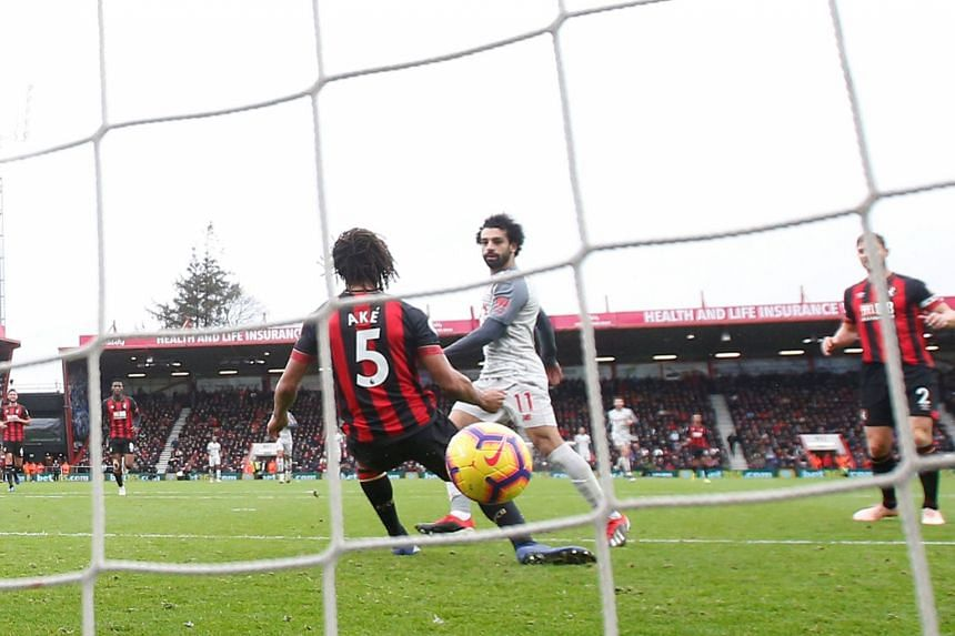 Liverpool's Mohamed Salah scoring their fourth goal against Bournemouth at the Vitality Stadium on Dec 8, 2018 to complete his hat-trick.