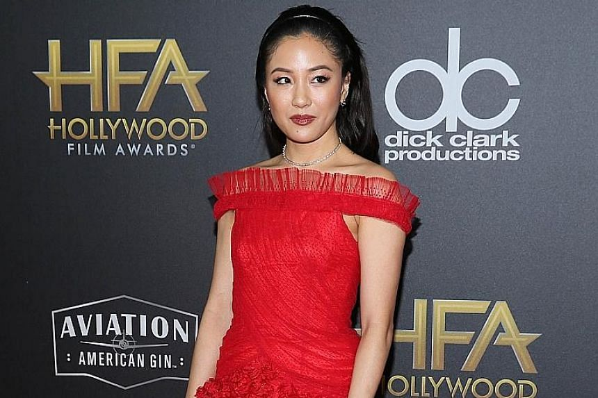 Asian-American actress Constance Wu, commenting on her nod for a Golden Globe acting award, says she is not carrying the torch alone.