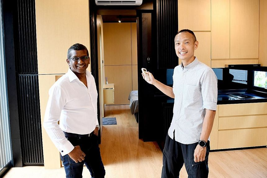 Buyers can customise the size of Movit homes. Pod Structures' chief executive officer Samuel Vedanaigam and chief operating officer Lee Kay Lian (above) at a Movit home, which comes with air-conditioning and a basic kitchen as well as a toilet .