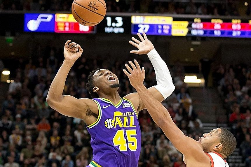 Rockets guard Eric Gordon knocking the ball away from Jazz guard Donovan Mitchell at Vivint Smart Home Arena in Salt Lake City, Utah. The home side won 118-91 to continue their good recent run.