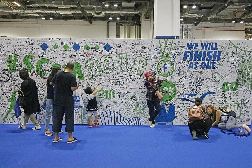 A wall for SCSM participants to write words of encouragement, aspirations and cheers at the . race pack collection in Marina Bay Sands Expo and Convention Centre yesterday.