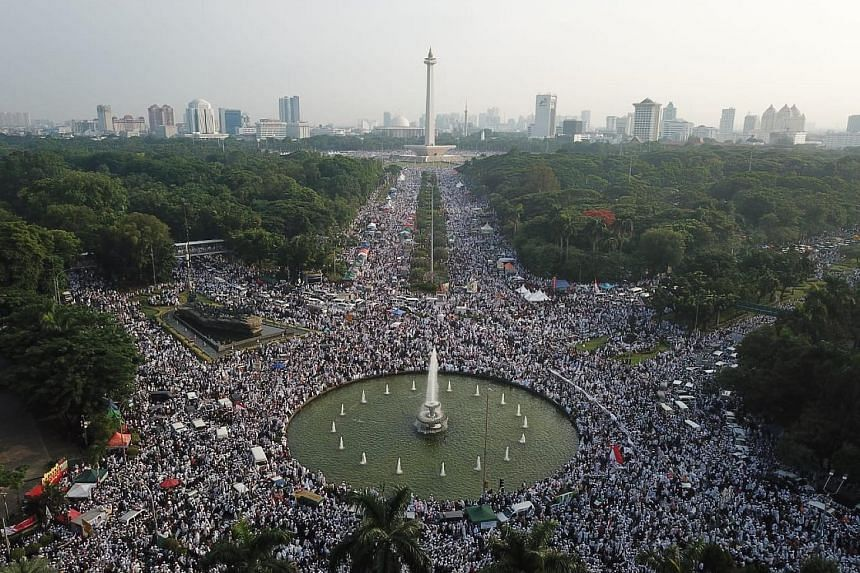 Hundreds of thousands of Muslims at Jakarta's Monas national monument last Sunday to mark the second anniversary of the Dec 2, 2016, protest against former governor Basuki Tjahaja Purnama for insulting Islam. Protesters at the Sunday rally called for