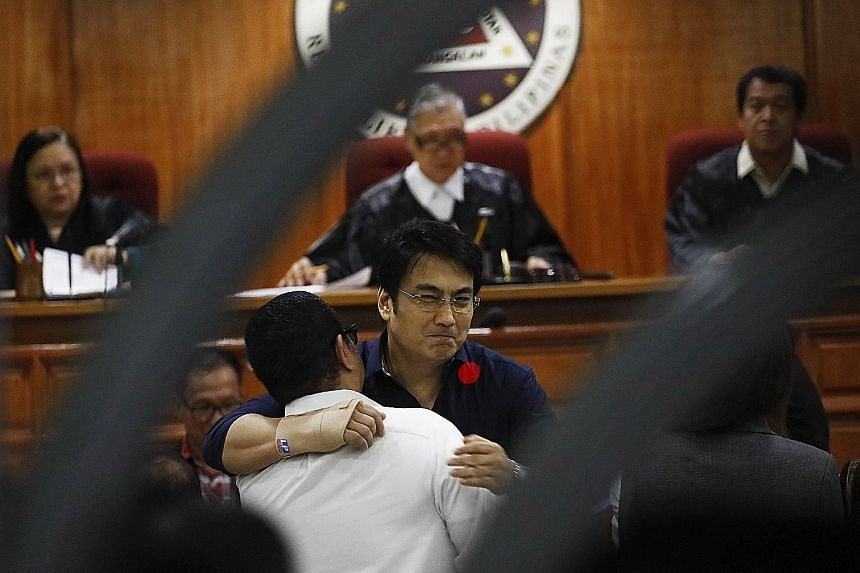 """Above: Political fixer Janet Napoles, the purported mastermind behind the """"pork barrel"""" scandal, was found guilty of plunder and sentenced to 40 years in jail. Right: Popular actor and former senator Ramon Revilla Jr (right) embracing his lawyer at t"""