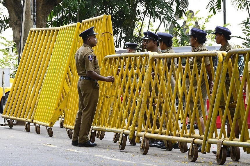 Police officers outside the Sri Lankan Supreme Court in Colombo yesterday as security was stepped up ahead of an expected ruling on whether the president broke the law by sacking Parliament.