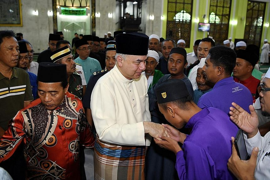 Worshippers at Masjid Al-Azim, Melaka, greeting Sultan Nazrin Shah yesterday. Malaysia's Deputy King said Islam has built a Malay race that is disciplined, honest, noble and sincere.
