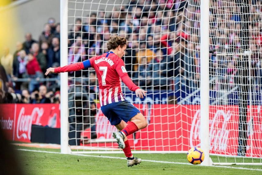 Atletico Madrid's Antoine Griezmann scores a goal during the Spanish La Liga soccer match between Atletico Madrid and Deportivo Alaves at Wanda Metropolitano Stadium in Madrid, Spain, on Dec 8, 2018.