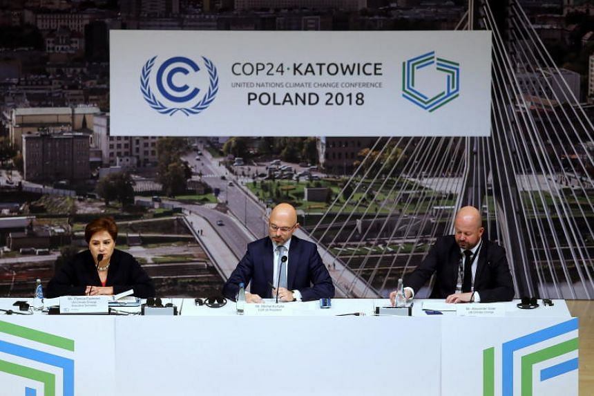 (From left) Executive Secretary of UN Climate Change Patricia Espinosa, Polish Deputy Minister of the Environment and chairman of the COP24 Michal Kurtyka, and Alexander Saier of Communications and Outreach UN Climate Change attend a press conference