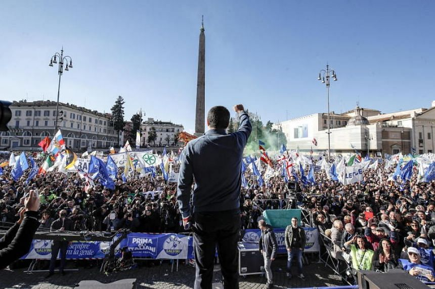 Italian Deputy Premier and Interior Minister Matteo Salvini gestures as he attends a rally staged by the League party in piazza del Popolo, central Rome, Italy, on Dec 8, 2018.