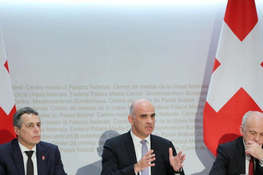 (From left) Swiss Foreign Minister Ignazio Cassis, Swiss President Alain Berset and Swiss Finance Minister Ueli Maurer attend a news conference on Swiss-EU relations in Bern, Switzerland, on Dec 7, 2018.