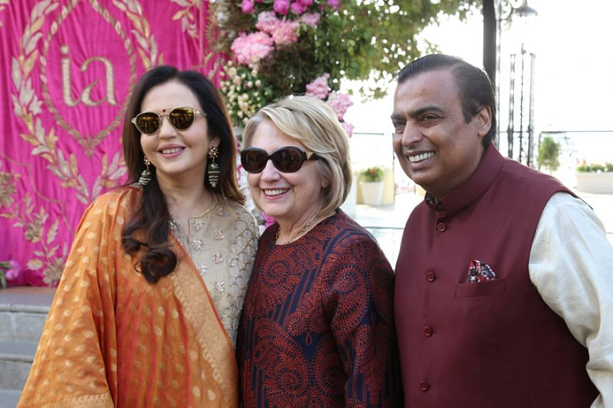 Former US secretary of state Hillary Clinton with Reliance Industries chairman Mukesh Ambani and his wife Nita during pre-wedding celebrations for their daughter Isha Ambani in Udaipur, India, on Dec 8, 2018.