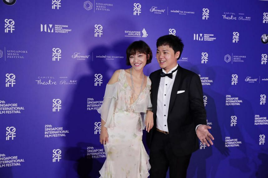 Chinese actress Luna Kwok and writer-director Yeo Siew Hua of A Land Imagined arrive for the Silver Screen Awards on Dec 8, 2018.