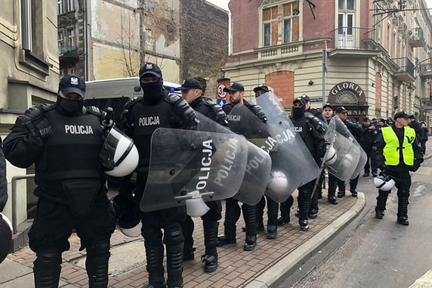 Protesters marched a 3km route under the watchful eye of Polish police clad in anti-riot gear.