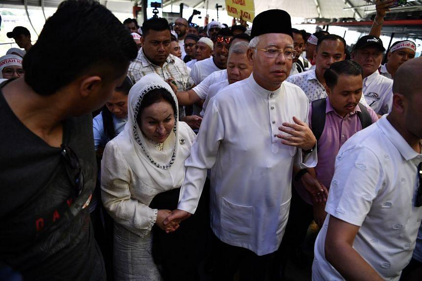 Former Malaysian PM Najib Razak and wife Rosmah Mansor taking the LRT to Dataran Merdeka.