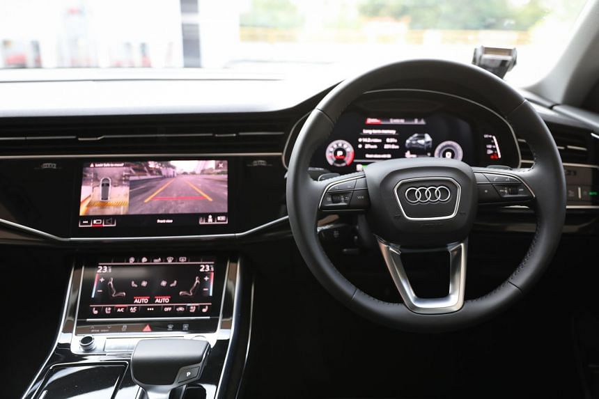 "The Audi Q8 has two large ""black mirror"" screens – one for infotainment and the other for climate control."