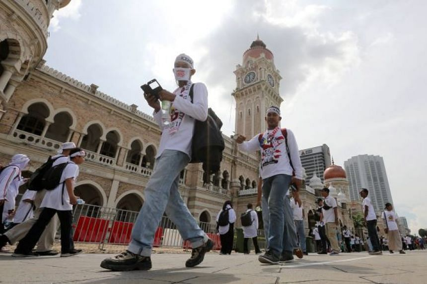 Roads heading to the iconic square have been closed ahead of the rally, where tens of thousands from across Malaysia are expected to come dressed in white.