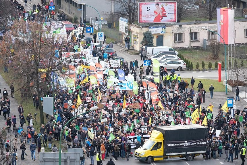 Participants of a march in Katowice, Poland, yesterday to call for more action to combat global warming. Singapore's Minister for the Environment and Water Resources Masagos Zulkifli is due to arrive in Katowice tomorrow, ahead of the high-level segm
