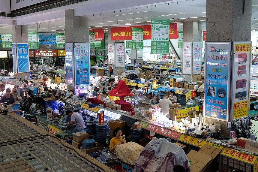 One of Shenzhen's Huaqiangbei electronic markets, where suppliers are packed elbow-to-elbow selling all sorts of electronic components.