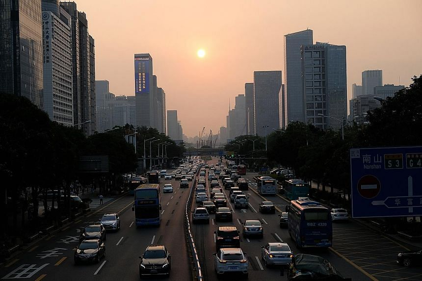 Shenzhen was an experimental field for China's economic reforms which began in 1978. Today, it is a booming mega-city of 20 million people, with skyscrapers lining the metropolis' Shennan Boulevard (above).