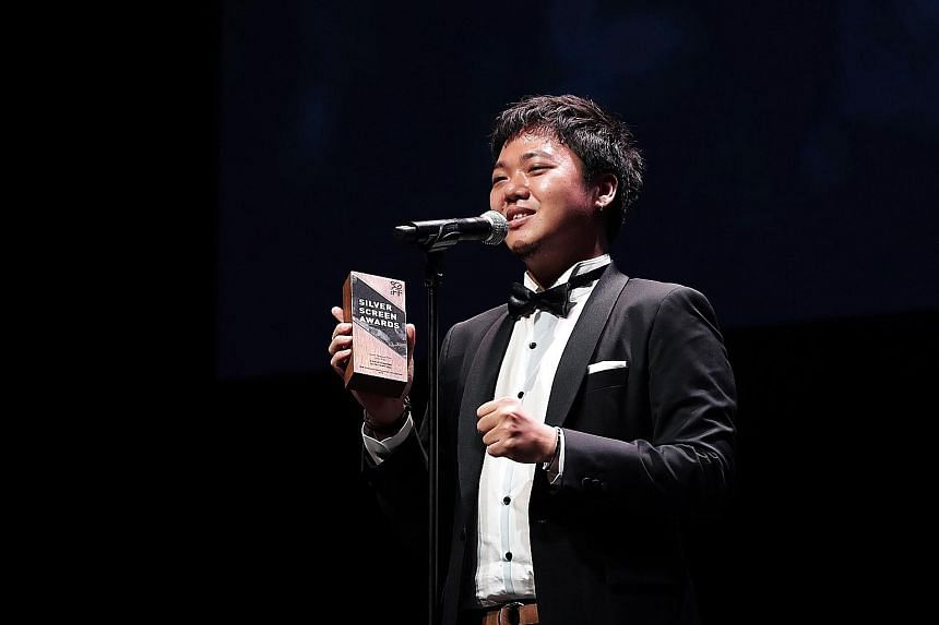 Yeo Siew Hua giving his acceptance speech at the Silver Screen Awards last night. His film, A Land Imagined, was picked by a jury of five industry professionals as the winner, from a shortlist of eight nominees. There are plans to release the film in