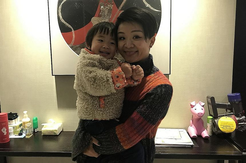 Beijing native Yuan Momo, 35, with her two-year-old daughter. She has an older son who just entered Primary One this year.