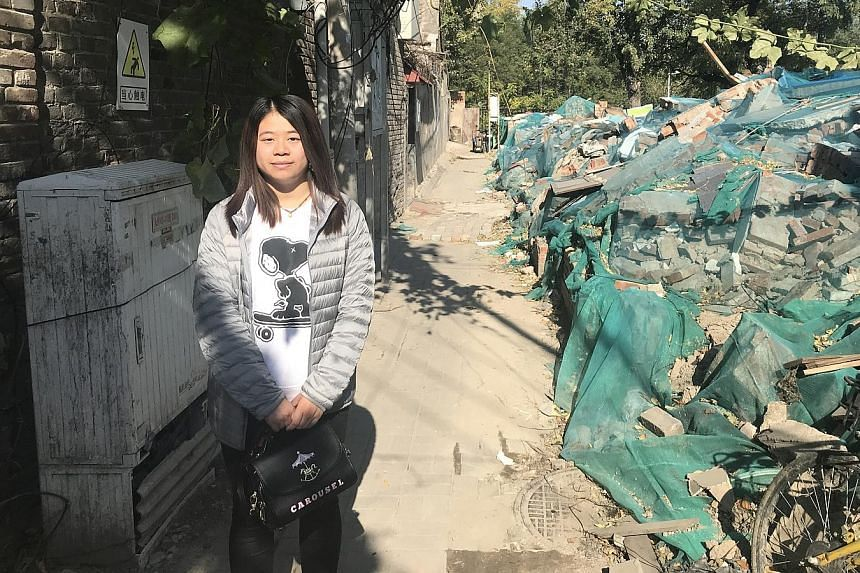 Ms Li Xue, 25, was born outside China's one-child policy and was not officially registered. She had to go to court to win the right to be registered.