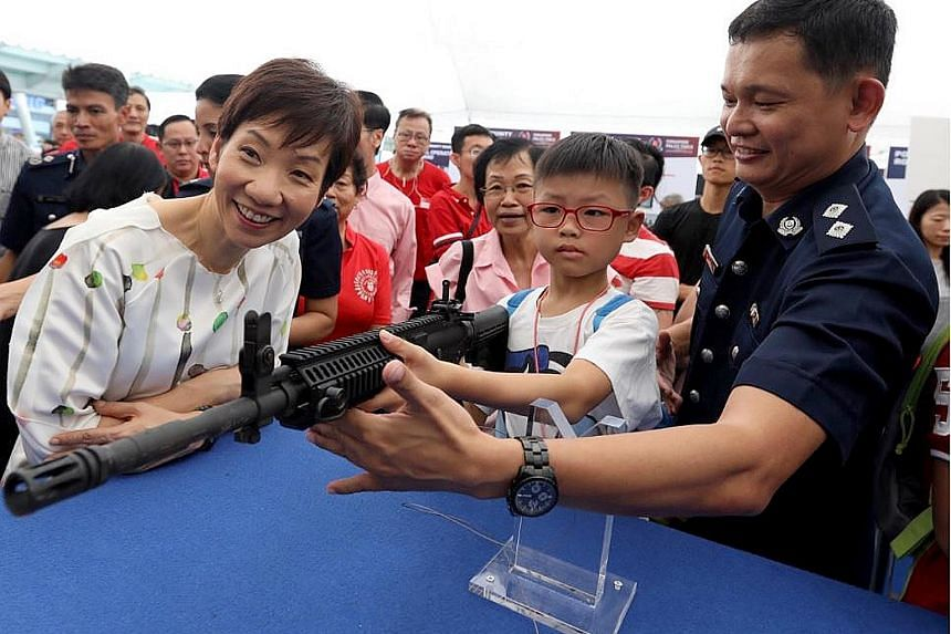 Minister for Culture, Community and Youth Grace Fu visiting a police community roadshow in Jurong East yesterday. She said the Police Coast Guard has been made even busier patrolling Singapore's waters recently because Malaysian vessels have started