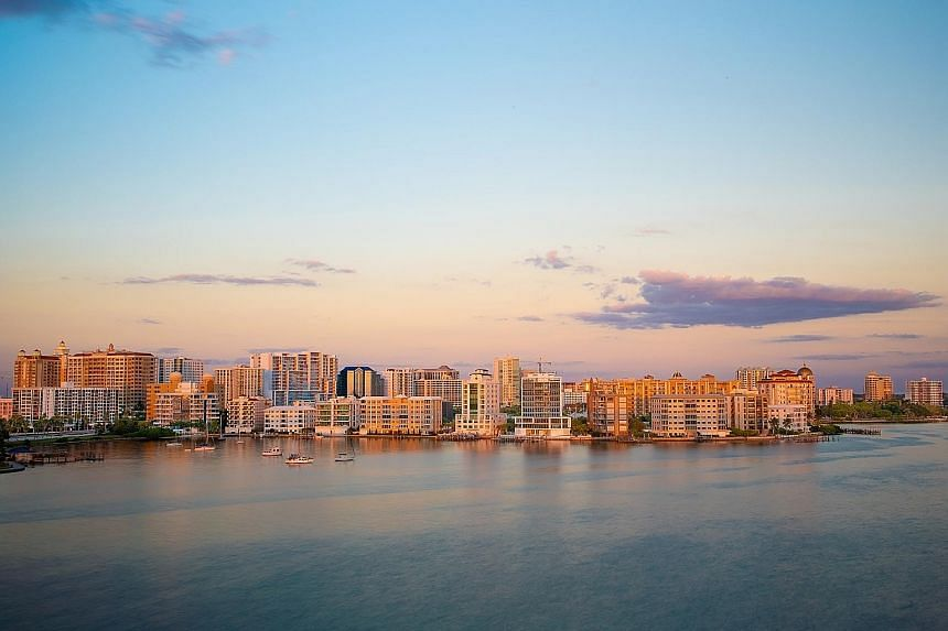 When the sunset in this shot (above) of Sarasota, Florida, turned out flatter than it appeared to the naked eye, software was used to intensify the colours for a warmer shot (top).