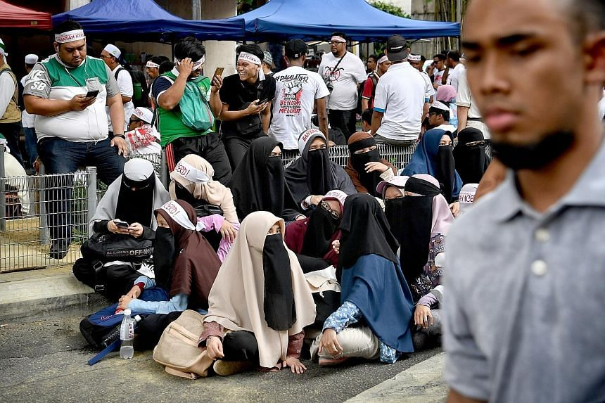 Left and top: Protesters gathering at Dataran Merdeka in Kuala Lumpur yesterday to take a stand against the United Nations' International Convention on the Elimination of All Forms of Racial Discrimination. Above: Former prime minister Najib Razak an