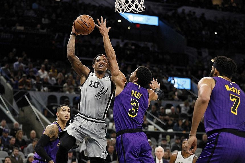 San Antonio Spurs shooting guard DeMar DeRozan taking a tough shot against his Los Angeles Lakers counterpart Josh Hart. DeRozan compiled 36 points, eight rebounds and nine assists, and made three baskets in a row with less than five minutes left to