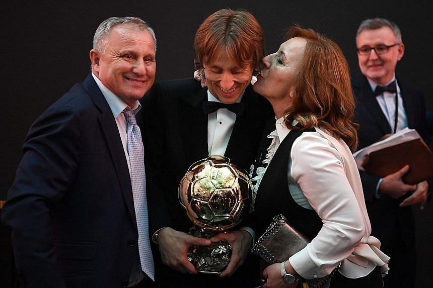 Real Madrid's Croatian midfielder Luka Modric with his parents after winning the Ballon d'Or award at the Grand Palais in Paris on Monday, breaking the 10-year duopoly of Cristiano Ronaldo and Lionel Messi. Dozens of Croats now play in the top footba
