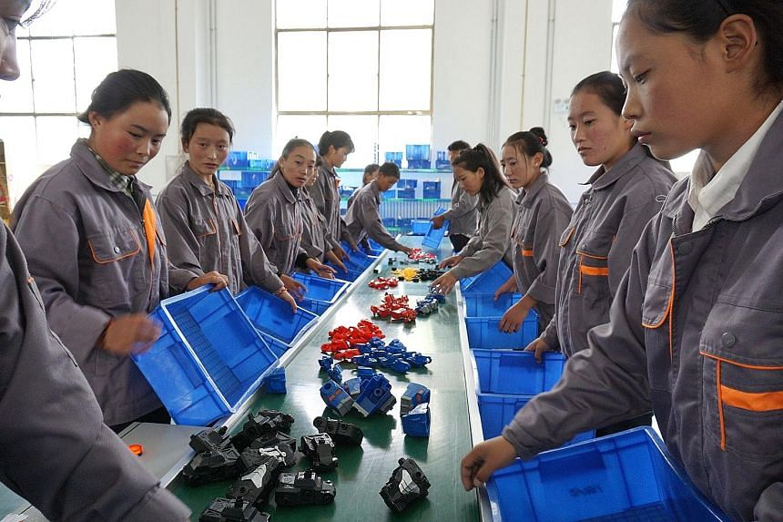 Students at Lhasa No.2 Secondary Vocational and Technical School in Lhasa City (above) learn basic vocational skills like assembly-line work at a mock factory. Their courses are fully subsidised by the local government.