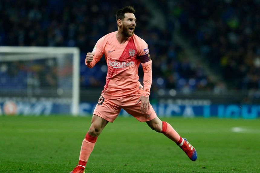 Lionel Messi celebrates after scoring during the Spanish league football match between RCD Espanyol and FC Barcelona at the RCDE Stadium in Cornella de Llobregat, on Dec 8, 2018.