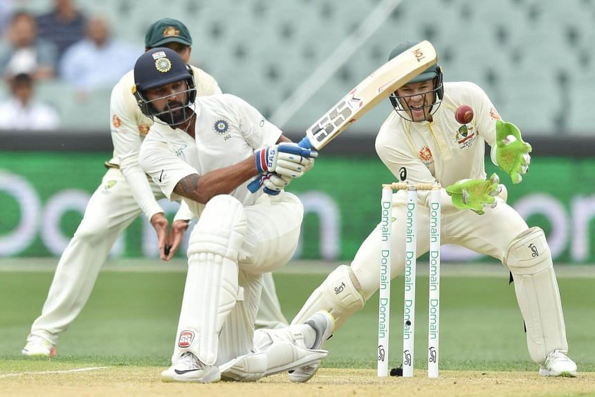 India's batsman Murali Vijay plays a shot in front of Australia's captain and wicket-keeper Tim Paine (right) during day three of the first Test cricket match at the Adelaide Oval on Dec 8, 2018.