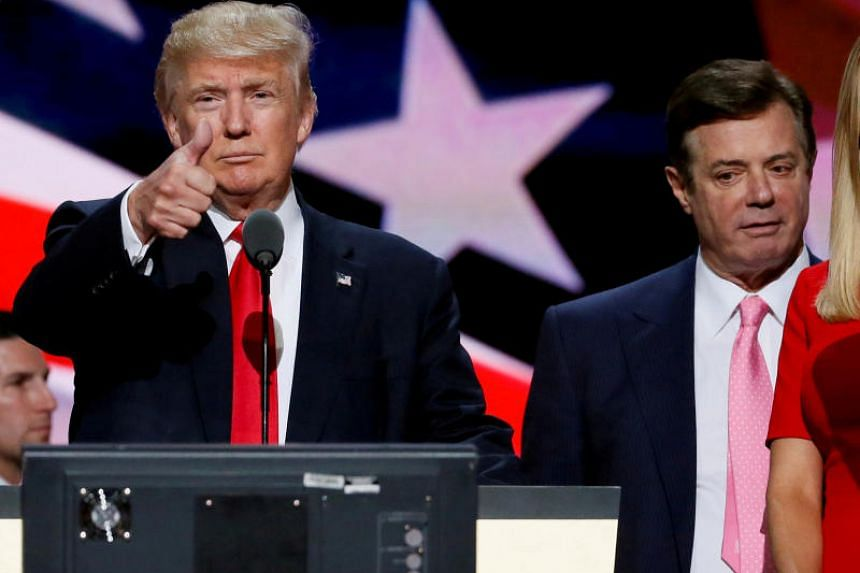 Republican presidential nominee Donald Trump gives a thumbs up as his campaign manager Paul Manafort looks on during Trump's walkthrough at the Republican National Convention in Cleveland, US, on July 21, 2016.