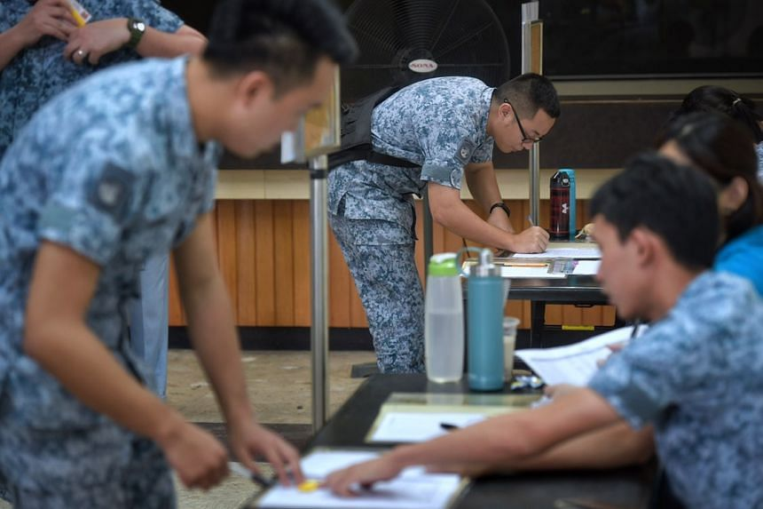 NSmen from the 142 and 149 squadrons, being called back as part of the ongoing regular mobilisation exercise at the Paya Lebar Airbase on Dec 9, 2018.