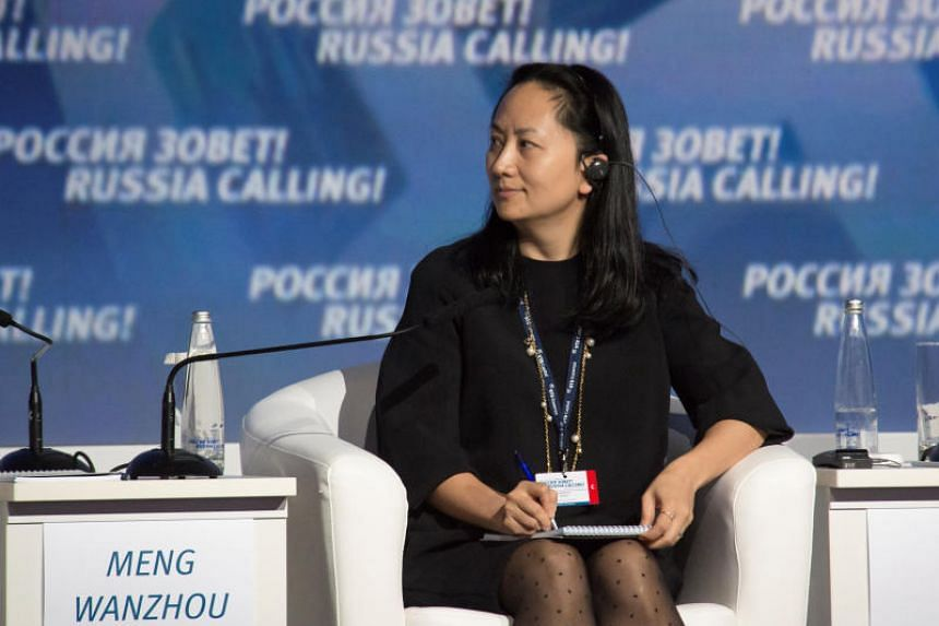 """Meng Wanzhou, Huawei's top executive, attends a session of the VTB Capital Investment Forum """"Russia Calling!"""" in Moscow."""