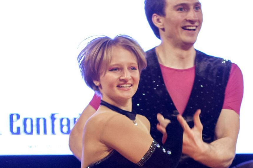 File photo of Katerina Tikhonova dancing with Ivan Klimov during the World Cup Rock'n'Roll Acrobatic Competition in Krakow.
