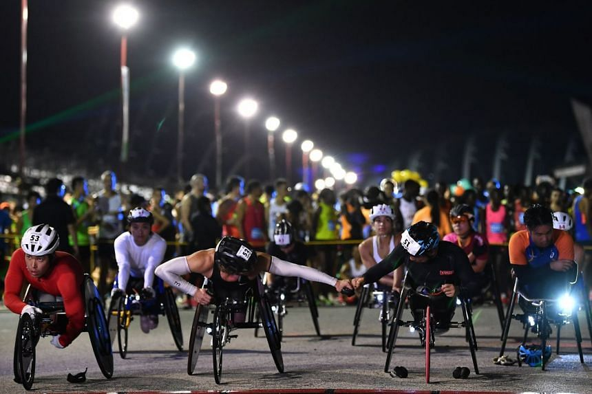 Elite wheelchair participants getting ready at the start line of Standard Chartered Singapore Marathon at F1 Pit Building on Dec 9, 2018.