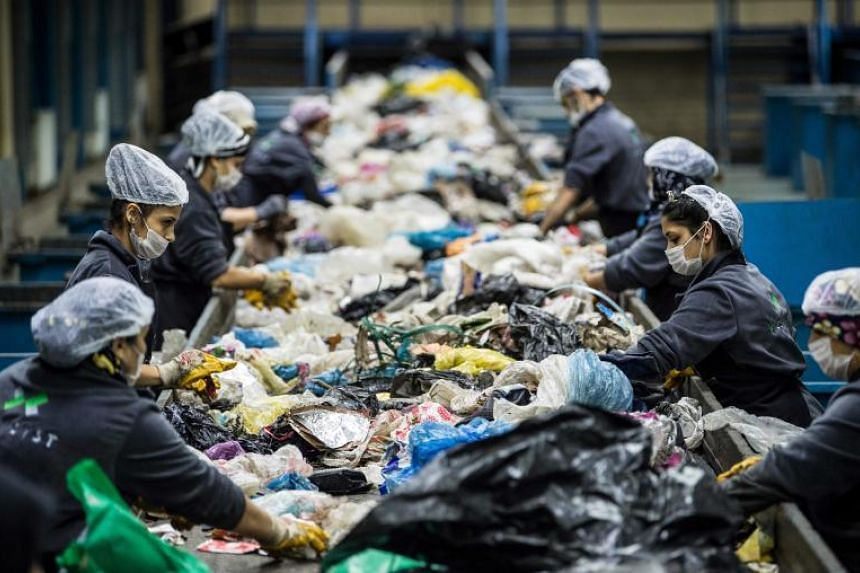 Turkish workers eliminate garbage in the recycling centre in Istanbul on Nov 14, 2018. The country of over 80 million people has notoriously bad record on recycling and waste. Activists say this needs to change fast and there are signs, albeit tentat