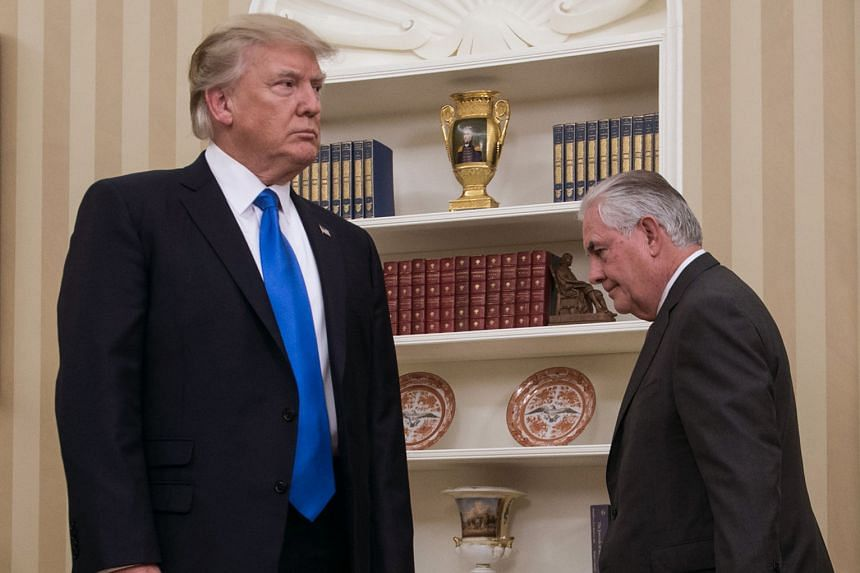 US President Donald Trump and Mr Rex Tillerson in the Oval Office of the White House ahead of the latter's swearing-in as secretary of state last year. Mr Trump sacked Mr Tillerson in March.